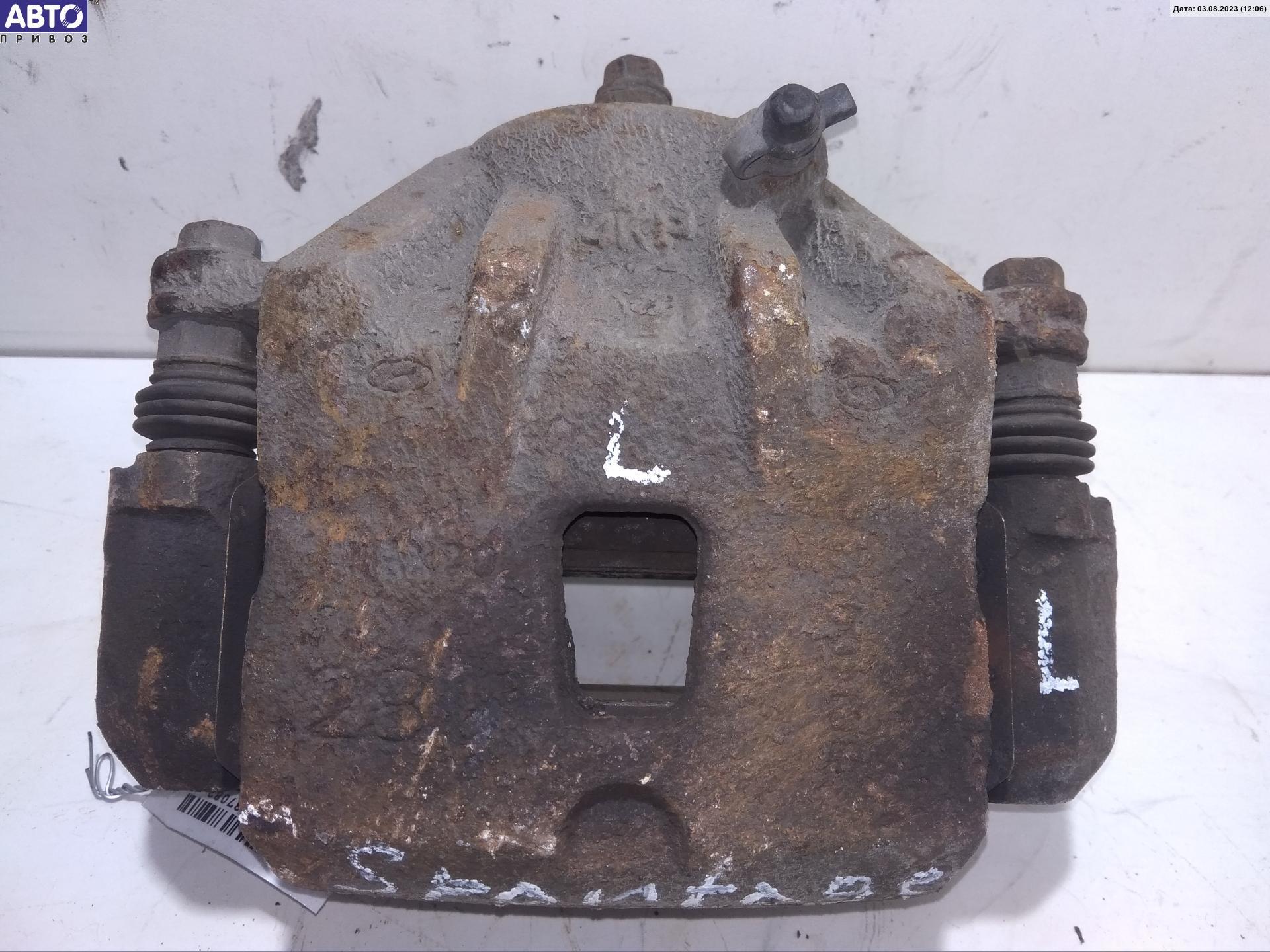 Суппорт тормозной передний левый Kia Sportage 2