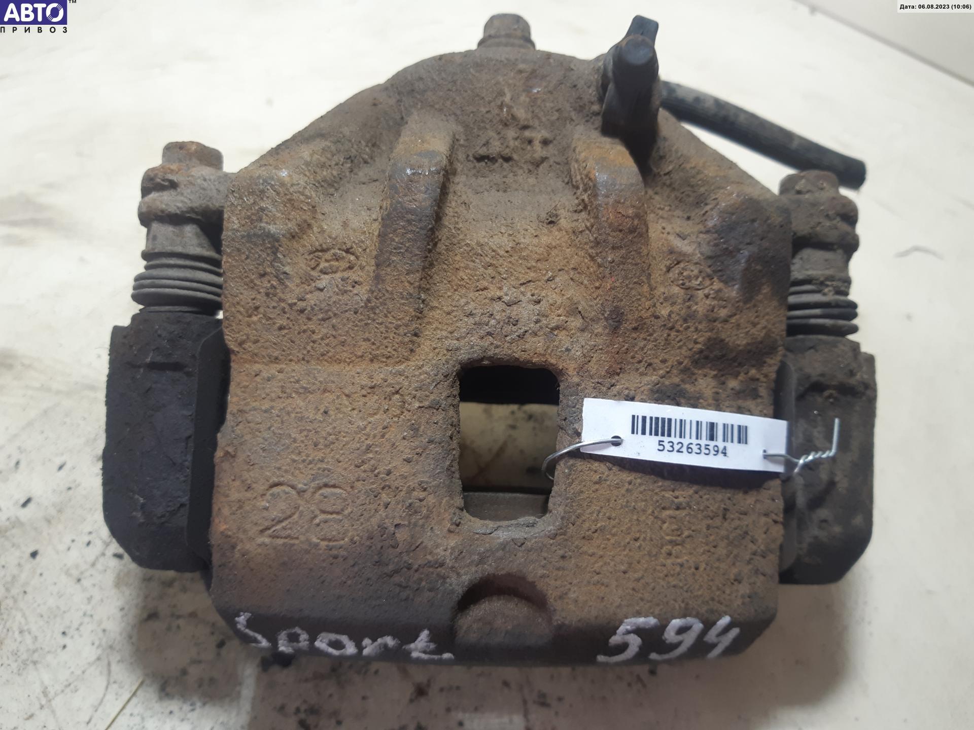 Суппорт тормозной передний левый Kia Sportage 2 5.81E+05