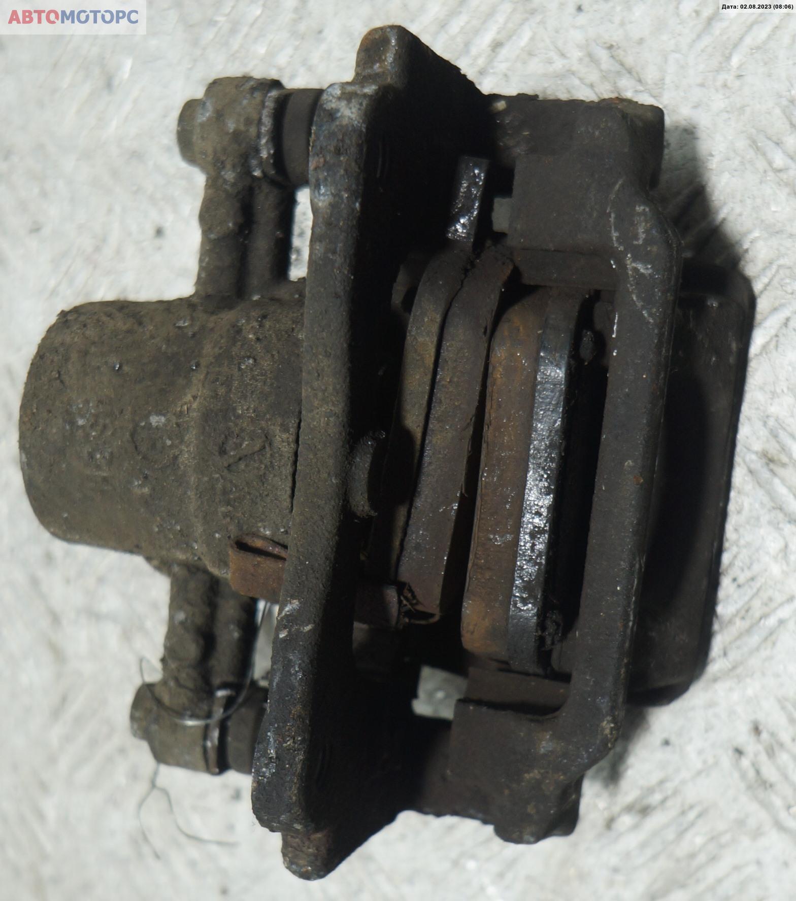 Суппорт тормозной задний правый Toyota