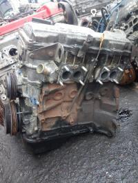 Головка блока цилиндров двигателя (ГБЦ) Nissan Sunny (1986-1991) Артикул 900176842 - Фото #1